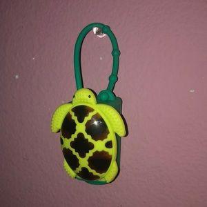 Aqua turtle hand sanitizer case.